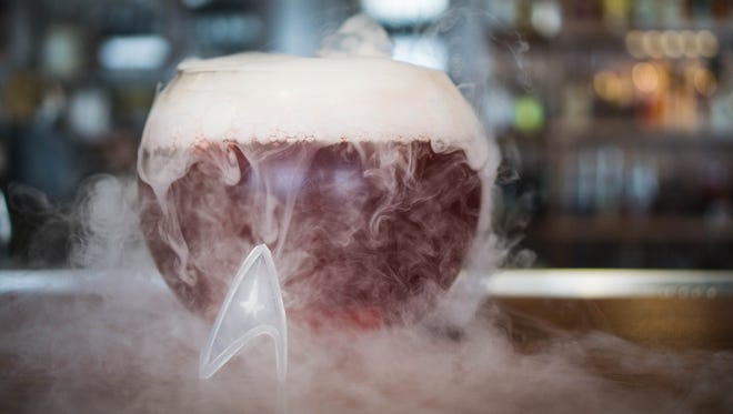 "The Warp Core Breach is a blend of Flor de Cana Silver, Kraken and Sailor Jerry rums with raspberry liqueur, passion fruit puree and a secret ingredient served in a large ""fish bowl"" style goblet."