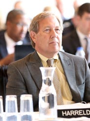 University of Iowa president Bruce Harreld listens