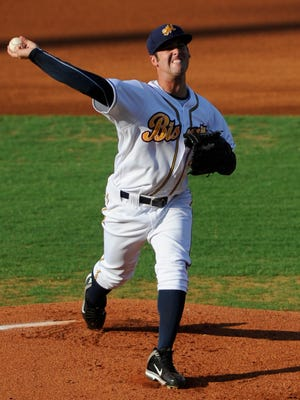 Montgomery Biscuits pitcher Dylan Floro throws against the Mississippi Braves at Riverwalk Stadium Montgomery, Ala. on Friday July 4, 2014.