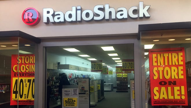 Signs hanging in the Radio Shack at University Mall in South Burlington Monday indicate the store will be permanently closing.