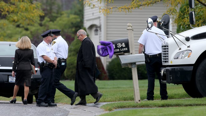 Monroe County Court Judge James Piampiano leaves the Tan home in Pittsford.