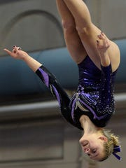 Melrose junior Mady Brinkman performs on the balance