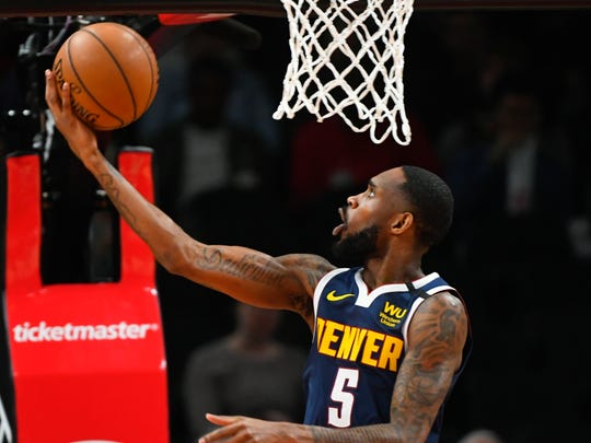 Denver Nuggets guard Will Barton shoots a reverse layup during an NBA basketball game against the Atlanta Hawks, Monday, Jan. 6, 2020, in Atlanta. (AP Photo/John Amis)