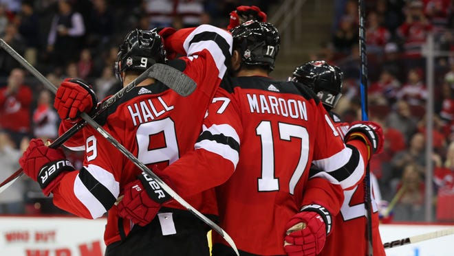 The New Jersey Devils celebrate a goal by New Jersey Devils left wing Patrick Maroon (17) during the second period of their game against the Montreal Canadiens at Prudential Center.