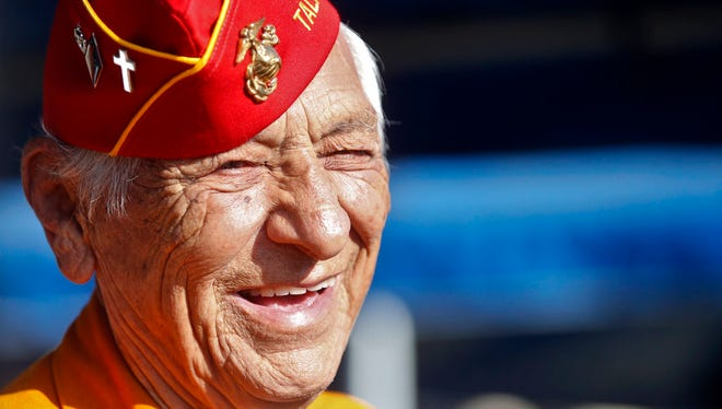 In this Sept. 28, 2015, file photo, former United States Marine and Navajo Code Talker Roy Hawthorne Sr. listens during a ceremony honoring the code talkers' contribution to the World War II U.S. effort, at Camp Pendleton, California.