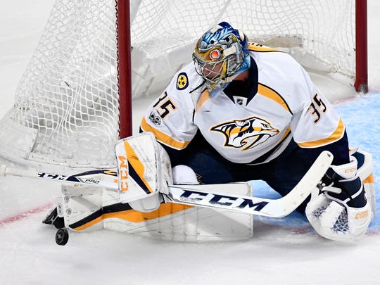 Nashville Predators goalie Pekka Rinne (35) makes a stop in the third period of game one in the first-round NHL playoff series at the United Center, Thursday, April 13, 2017, in Chicago, Ill.