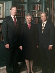 Former Wilmington Trust employee Erika Bush with former bank president Robert V.A. Harra Jr. (left) and former CEO Ted Cecala.