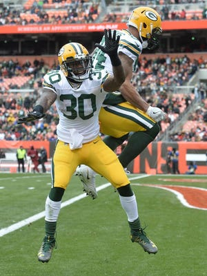 Green Bay Packers running back Jamaal Williams (30) and tight end Lance Kendricks (84) celebrate Williams' touchdown during the first quarter against the Cleveland Browns at FirstEnergy Stadium.
