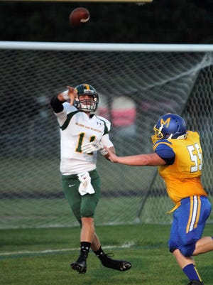 Burr and Burton quarterback Griff Stalcup lofts a pass during his team's Week 3 football game against Milton.