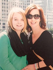 Kari Rhinehart, right, and her daughter Emma  Findley, left, who was diagnosed with cancer at age 13, and passed away in 2014.