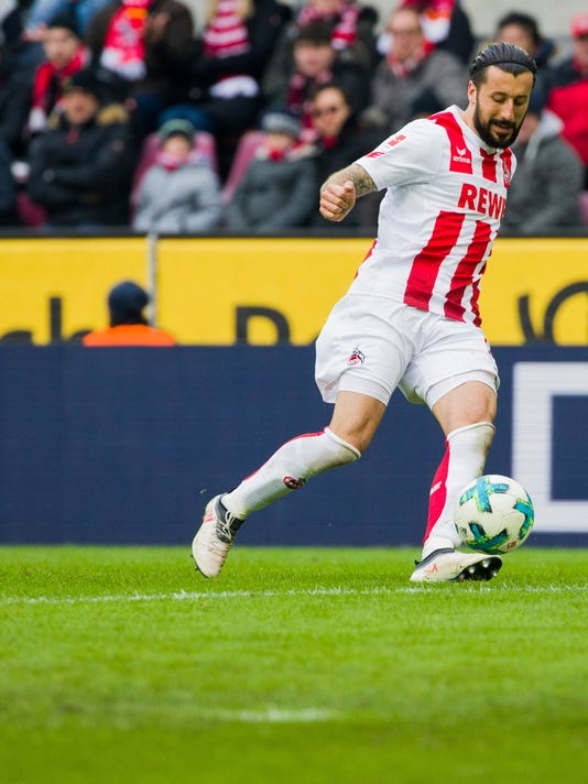 FILE - In this March 18, 2018 file photo, Cologne's Dominic Maroh plays the ball during the German Bundesliga soccer matc between 1.FC Cologne and Bayer 04 Leverkusen, in Cologne, Germany. Cologne defender Dominic Maroh had tears in his eyes after his team defeated Bayer Leverkusen in the Rhine derby. It was just Cologne's fifth win in 27 games but it dragged the club off the bottom of the table for the first time since the second round.  (Rolf Vennenbernd/dpa via AP,file)