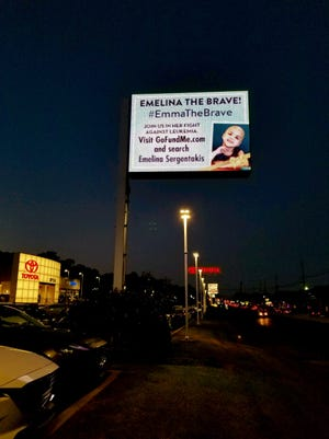 When Michael Rendine of Crystal Auto Mall heard of Emma's battle with cancer, had a sign put up in front of the dealership with the link to her GoFundMe.