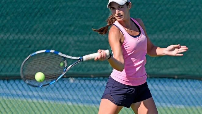 Pensacola Catholic's Lizzie Nowak pratices at Roger Scott Tennis center Saturday, April 28, 2018.