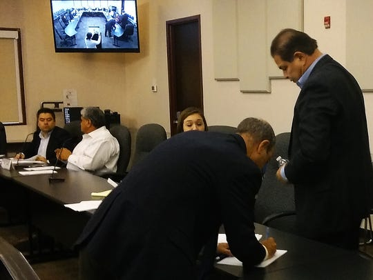Larry Romero, right, agreed to sign a letter of reprimand