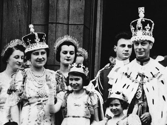 An image of King George VI and Queen Elizabeth, with their family on the balcony at Buckingham Palace, London on coronation day, May 12, 1937. Elizabeth, later Queen Elizabeth II, is the taller of the two children at the front of the image.