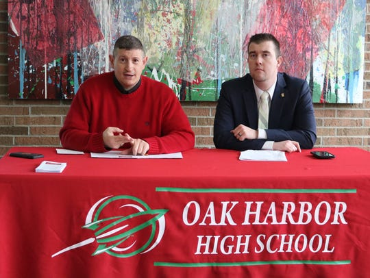 Guy Parmigian, left, superintendent of Benton-Carroll-Salem Schools, and Treasurer Cajon Keeton addressed concerns about school district salaries at a news conference last year.