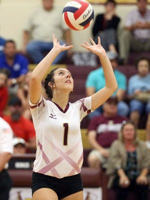 GABE HERNANDEZ/CALLER-TIMES Tuloso-Midway's Jamie Horman sets the ball against Veterans Memorial on Tuesday at Tuloso-Midway High School.
