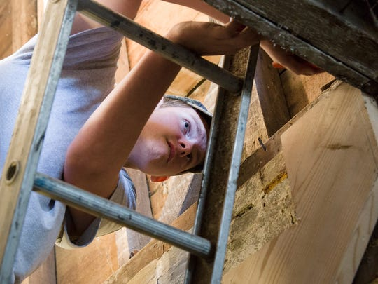Alex Lord begins the process of building stairs into the basement. A house on South Broad Street in Middletown is being renovated by volunteers as part of the Warriors Helping Warriors organization's effort to create a veterans center.