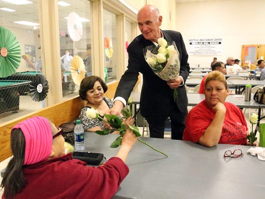 County judge candidate John Cook hands out roses ahead of Mother's Day during a visit Tuesday to the South El Paso Senior Center.