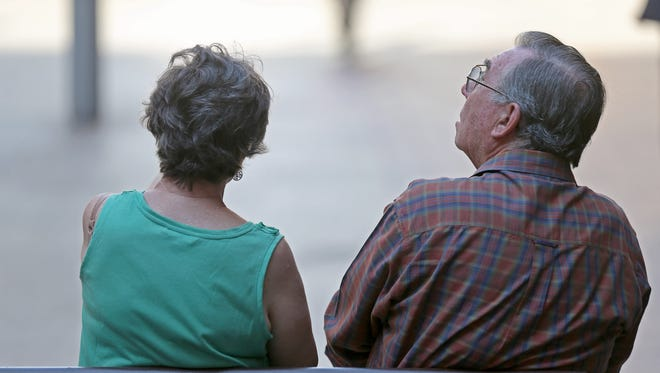 In this Wednesday, Oct. 9, 2013 photo, an elderly couple sits on a bench in central Sydney.