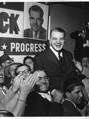 Republican gubernatorial candidate Christopher Del Sesto celebrates in Silver Lake after the Nov. 6 election in 1956. Hours before his inauguration, the Rhode Island Supreme Court threw out the mail ballots that had given Del Sesto his win.