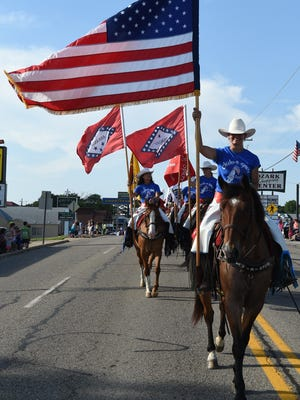 Horses and flags were big during the 17th Annual Red White & Blue Parade as it traveled through Mountain Home's downtown Friday evening.