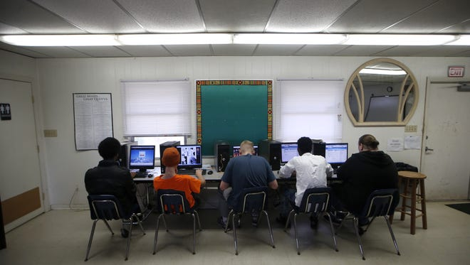 Students in a high school level English class work on computers in a portable, a trailer-like school classroom, at Pace Secondary School on March, 31, 2016.