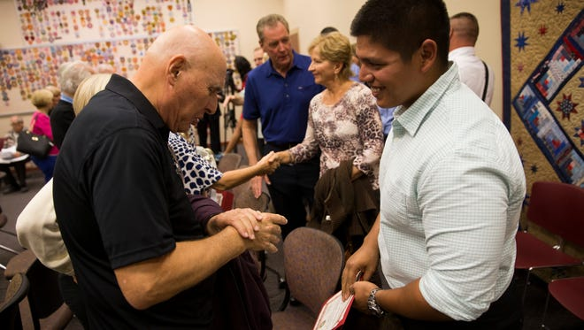 Ron Katz, left, greets Jon Hernandez at the conclusion of the Phoenix Awards ceremony at Bonita Springs Fire Station Four Monday, Jan. 8, 2018 in Bonita Springs. Hernandez, along with three other civilians, were given the Phoenix Award, the most prestigious honor given to those who saved a life, by the Bonita Springs Fire Control and Rescue District for their role in saving Katz life after he suffered from cardiac arrest while playing tennis in September of last year.