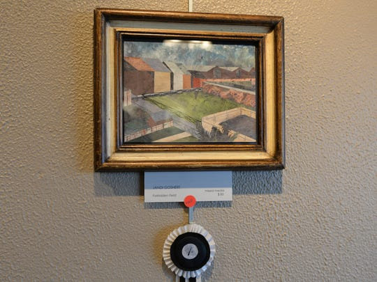 'Forbidden Field' won first prize for local artist Jandi Goshert at the second annual Paint the Town juried exhibition held at Lebanon Picture Frame & Fine Art, at 45 S. Eighth Street in Lebanon, on April 1, 2016. The artists focused on Lebanon, PA.