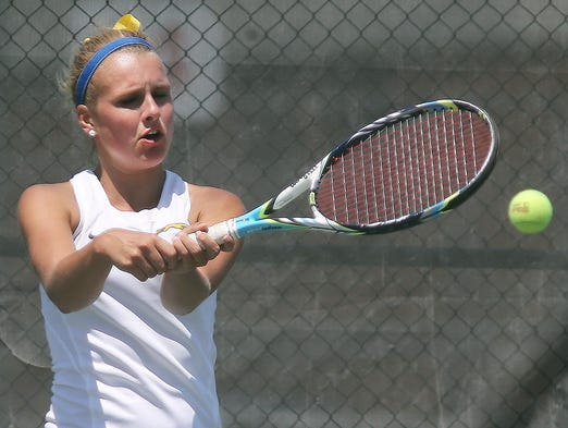 Bailey Padgett hits a return for Carmel in the number one singles match. Carmel met North Central in the state team tennis finals at North Central High School Saturday June 7, 2014.