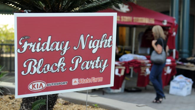 People enjoy drinks and music at the FSU Block Party at Kleman Plaza April 13th.