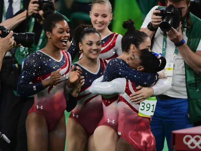 U.S. gymnasts celebrate after the women's team final