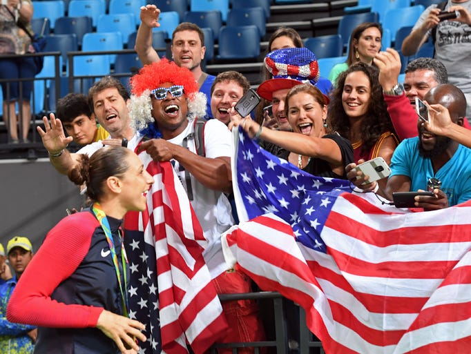 USA's guard Diana Taurasi poses with fans after the