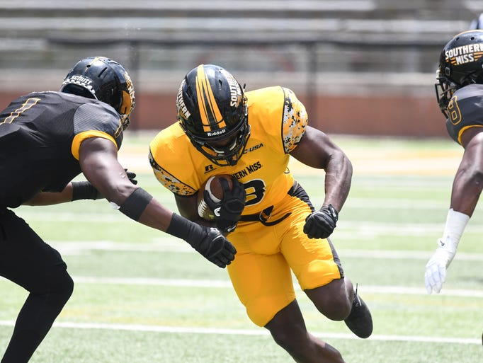 Southern Miss running back Tez Parks runs with the
