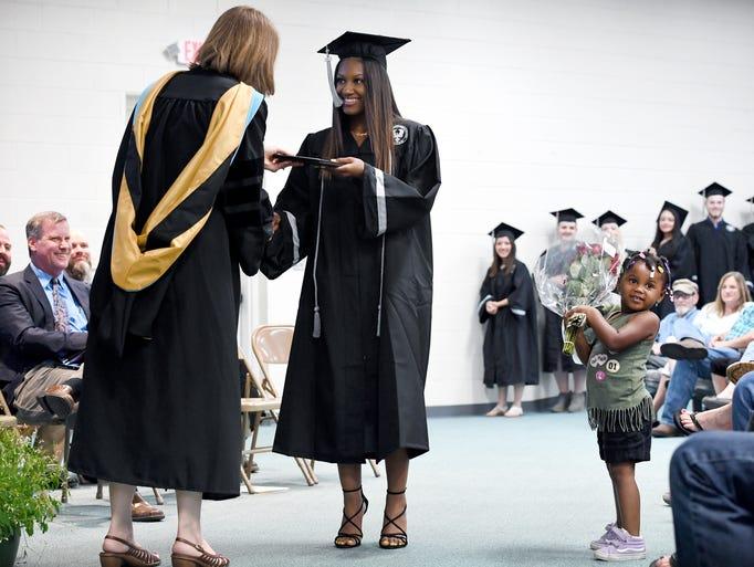 Graduate Taneea Capri Johnson-Wilcoxson receives her