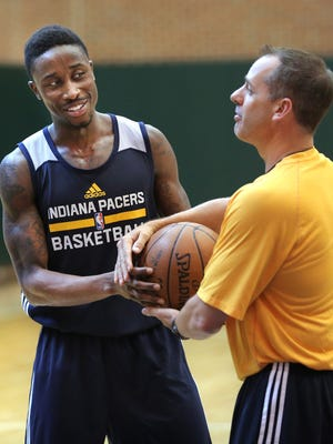 Jon Octeus of Purdue jokes around with Pacers head coach Frank Vogel during the Pacer workout at Bankers Life Fieldhouse on Tuesday, June 2, 2015.