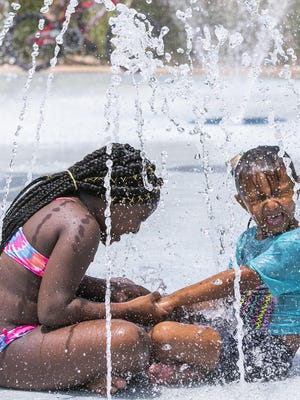 Finding some cool water will be important this week, same as last week, according to the forecast from the National Weather Service. In this shot from last week, Yakyri Williams, 9, holds hands with Lily Lakovich, 6, while sitting in the middle of a fountain at Lily's Splash Pad at the Lillian F. Bryant Community Center in Ocala.