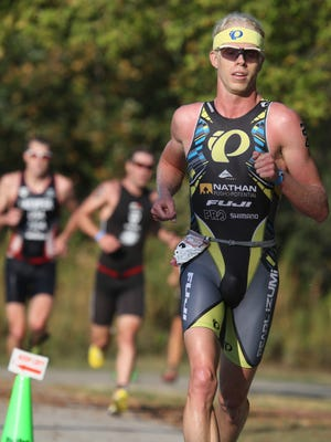 Cameron Dye of Boulder, Colo., competes in the men's Elite Cup at the Hy-Vee Triathlon on Sept. 1, 2013, at Gray's Lake Park.