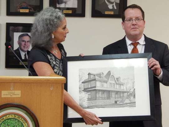 Jane Frost-Guzzo is presented with the train station