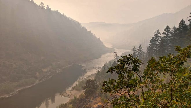 The iconic Rogue River in Southern Oregon covered in smoke Sunday afternoon.