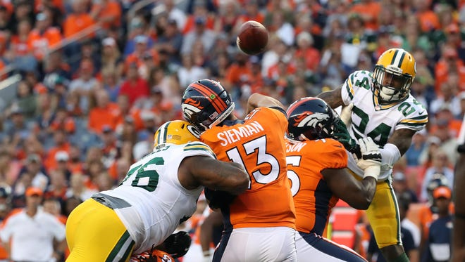 Green Bay Packers defensive end Mike Daniels (76) hits Denver Broncos quarterback Trevor Siemian for an incomplete pass.