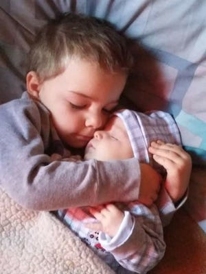 Waylon Matthews holds his baby brother Lawless. A video of the brothers went viral on Facebook, reaching more than 58 million views.