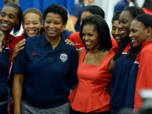 2012: First lady Michelle Obama led the U.S. delegation to London. Here, she poses for a photograph with members of the USA Olympic women's basketball team.