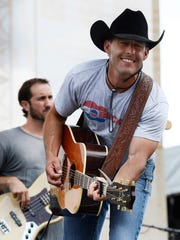Aaron Watson performs at the Riverfront stage during the CMA Music Festival on Saturday, June 13.