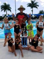 Posing with their team trophies are, from left,  Team Bolts swimmers Aniela Kelly, Mya Harris, Coach Bill, Evelyn Carderiche, Ian Sutter, Cadence Blackwell Bottom Row: Mia Lombardi, Estelle Carderiche, Kendra Cogar, Madison Mason