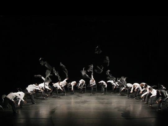 """In this undated image released by Alvin Ailey American Dance Theater, dancers clad in black suits and hats perform in """"Minus 16,"""" choreographed by Ohad Naharin in New York."""