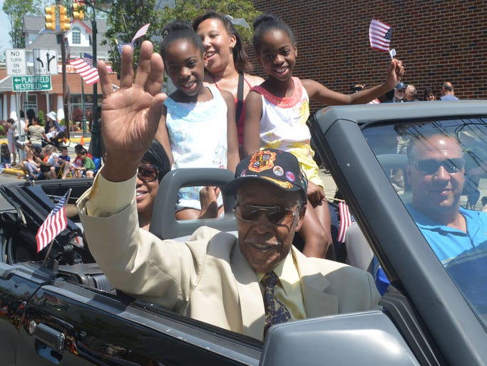 Fanwood Memorial Day parade grand marshal Malcolm Nettingham waves to the crowd, accompanied by members of his family, during the Fanwood parade. Nettingham, 95, is a World War II veteran and served with the famed Tuskegee Airmen unit during the war.