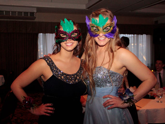 Rachel Odenthal (Left) Leah Schellinger wear masks during prom for St. John's Preparatory School Saturday at the Hotel Le St. Germain in St. Cloud.