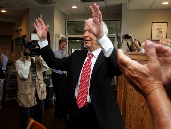 Sen. Thad Cochran greets supporters as they cheer his entrance at McElroy's in Ocean Springs, Miss., on June 24, 2014. Cochran won the GOP primary runoff over challenger Chris McDaniel.