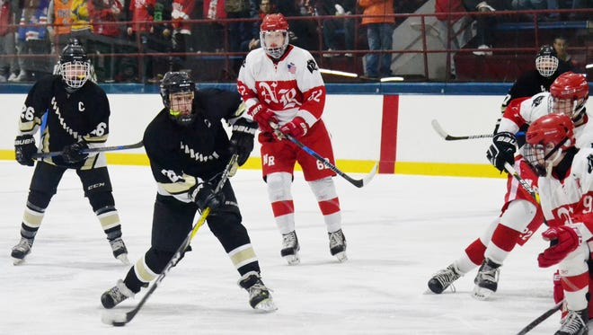 Clarkstown forward Dean Baumann shoots through traffic on Saturday during a 2-1 win over North Rockland at Sport-O-Rama.